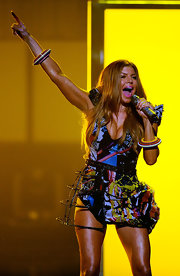Fergie looked fabulous while she performed live at the 2010 American Music Awards. The multi-colored, futuristic bracelets added extra dimension to complement her show-stopping ensemble. Always a fashionista, Fergie proved that when it comes to accessories bigger is better.