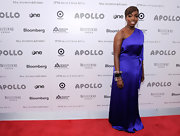 Estelle looked stunning in a vibrant purple one shoulder evening gown.