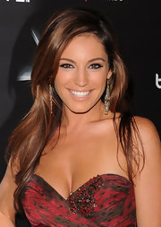 Kelly Brook paired her strapless dress with gold dangle earrings and long flowing curls.