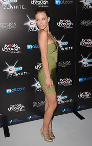 AnnaLynne paired her sexy green dress with elastic-strapped slingbacks.