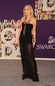 Model Jessica Stam showed off her bod in a sheer dress, which she topped off with a bronzed statement necklace.