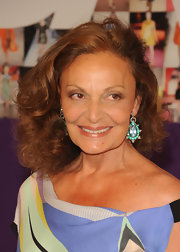 Diane Von Furstenberg showed off her dangling gemstone earrings which looked ravishing against her bronzed skin.