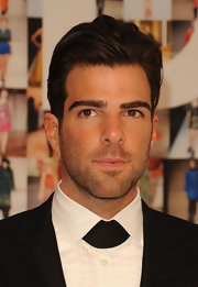 Zachery Quinto slicked his hair back while attending the CFDA Awards.