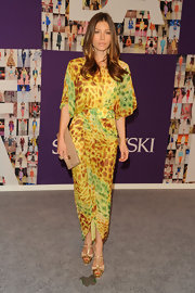 Jessica Biel toned down her vibrant printed dress with a nude patent leather with just a bit of gold hardware to complement her cocktail ring.