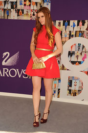 Kate Mara paired her coral frock with a gold belt and metallic clutch.