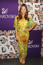 Jessica paired her vibrant DVF wrap dress with metallic and cream strappy evening sandals.