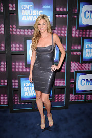 Erin looked stunning in a sparkling bandage dress with nude patent Private sandals.
