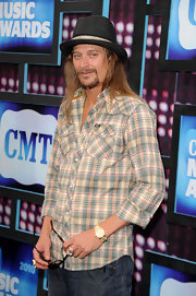 Kid Rock paired his plaid shirt with a cool black fedora hat.