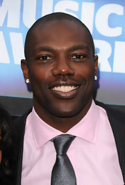 Terrell Owens showed off his large diamond earrings while hitting the red carpet at the CMT Awards.