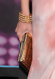 Faith Hill added a dash of edge to her look with a spiked gold bracelet.