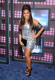 Snooki paired her poof with platform cutout sandals for a little added height.