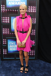 Carrie Underwood paired her bright dress with a gemstone inlaid clutch.