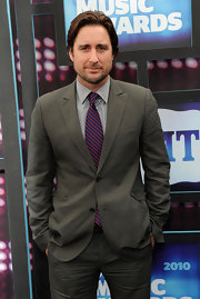 Luke Wilson added some flair to his look with a striped tie.