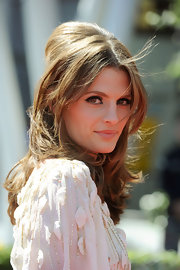 Stana showed off her voluminous half up half down hairdo while hitting the Emmy Awards.