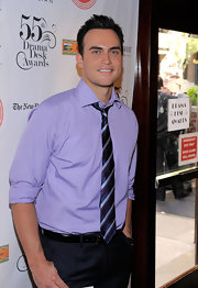 Cheyenne Jackson looked cool and carefree in a striped pastel blue button-down shirt with rolled-up sleeves.