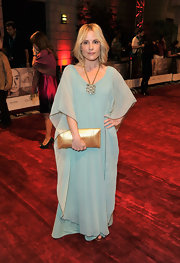 Emma shows her fashion savvy at the Dubai Film Festival in a soft blue chiffon gown gown and gold clutch.