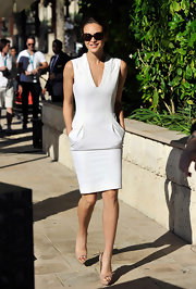 Beau is so chic in a little white dress with handy pockets.