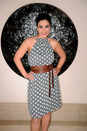 Seba wears a darling polka dot day dress with a thick leather belt.