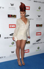 Eva carried a white beaded clutch with her shining sequined mini-dress.