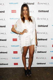 Samantha looks like quite the model in this white fringe dress with a tie belt.