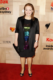 Jacki wears a sleek black satin blazer over a colorful sequined blouse for the 2010 Inside Film Awards.