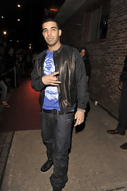 Drake paired his casual jeans with a cool leather jacket and graphic T-shirt.