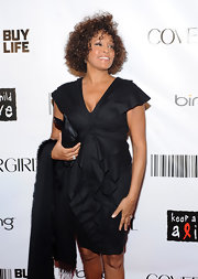 The late Whitney Houston attended the 2010 Black Ball wearing a luxe ruffled LBD.