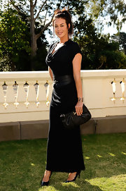 Megan Gale completed her all-black ensemble at the 2010 L'Oreal Melbourne Fashion Festival with a Christian Louboutin leather clutch.
