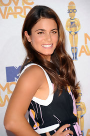 Nikki Reed completed her look with soft waves that were elegantly swept to one side.