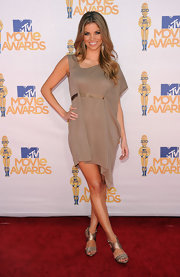 Amber Lancaster opted for an asymmetrical mink-hued dress for her awards show look.