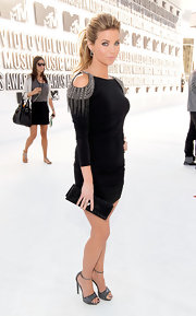 'The Hard Times of RJ Berger' star Amber Lancaster attended the 2010 MTV Video Music Awards sporting a  black Swarovski crystal clutch.