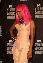 Nicku attended the MTV VMA's in a peach jumpsuit. Her sleeveless number showed off her Chinese lettering tattoo.