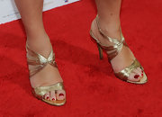 Jane showed off her gold strappy sandals while hitting the red carpet.