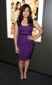 America showed off her classic style in a fitted vibrant purple day dress. She paired her frock with peep toe pumps.