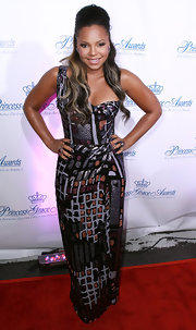Ashanti wears a unique floor length dress with shimmering details.