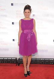 Karen paired her a chiffon and lace lavender dress with black satin Sergio Rossi pumps.