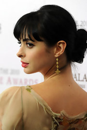 Actress Krysten Ritter attended the 2010 Hollywood Style Awards wearing 18-karat gold and rose cut diamond 3 tier Aladdin Flower earrings.