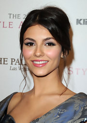 Victoria Justice added a little drama to her look with fluttering lashes.