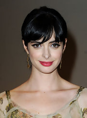 Krysten Ritter wore satin red lipstick to the 2010 Style Awards. Her look was completed with rosy cheeks.