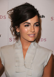 Camilla Belle highlighted her messy updo with simple hoop earrings.