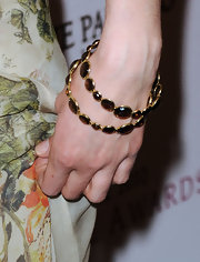 Actress Krysten Ritter attended the 2010 Hollywood Style Awards wearing two 18-karat gold mini Lollipop bangles in smoky quartz.