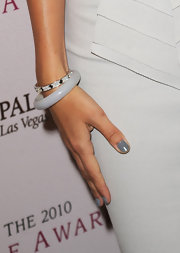 Camilla Belle added a subtle touch to her look with a diamond bracelet.