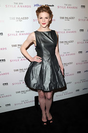 Ashley Bell paired a darling metallic cocktail dress with black platforms. The satin peep toes complemented the dress' tulle detail.