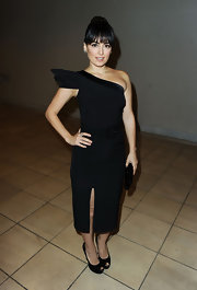 Ana paired a fashion forward one shoulder dress with black platform pumps.