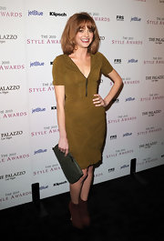 Jayma Mays paired her chartreuse dress with a sage colored clutch. The leather clutch features a subtle hint of glitter.