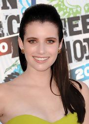 The actress opted for a straight, half-up hairstyle with gold stud earrings and shimmering shadow.