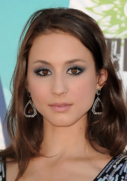 Troian Bellisario glammed it up with a pair of huge teardrop earrings at the 2010 Teen Choice Awards.