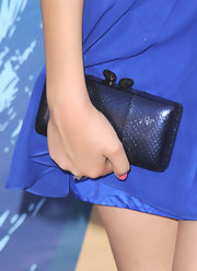 Victoria Justice carried a black J.B. Renna Ayers snakeskin clutch by Kotur at the 2010 Teen Choice Awards.