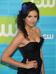 Nina topped her side curls off with a cute feather headband.