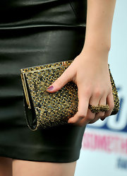 Levan showed off her beaded hard case clutch while walking the red carpet at the Do Something Awards.